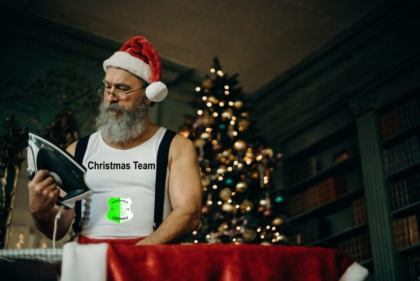 man-in-white-tank-wearing-santa-hat-holding-black-and-gray-3149895